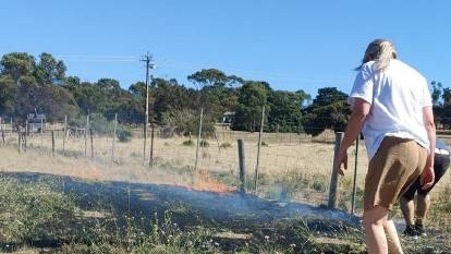 HELP: Civilians do their bit to control a small grass fire near Port Lincoln. Photo: Alana Jantke