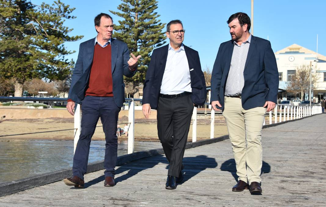 DISCUSSION: Premier Steven Marshall discusses tourism with Member for Flinders Peter Treloar and EPLGA president Sam Telfer on the Port Lincoln jetty.