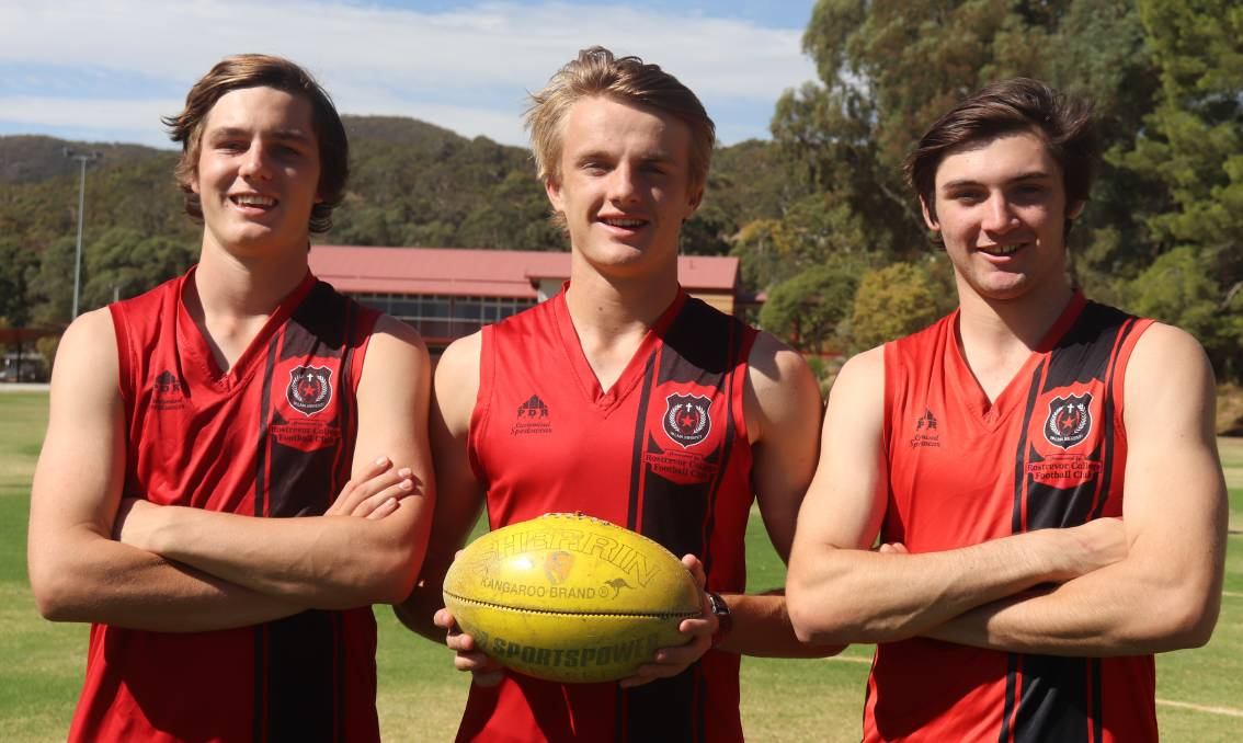 SQUAD: Ben Jarvis, Jacob Kennerley and Cameron Taheny, pictured in Rostrevor gear, will try out for the state under 18 team.