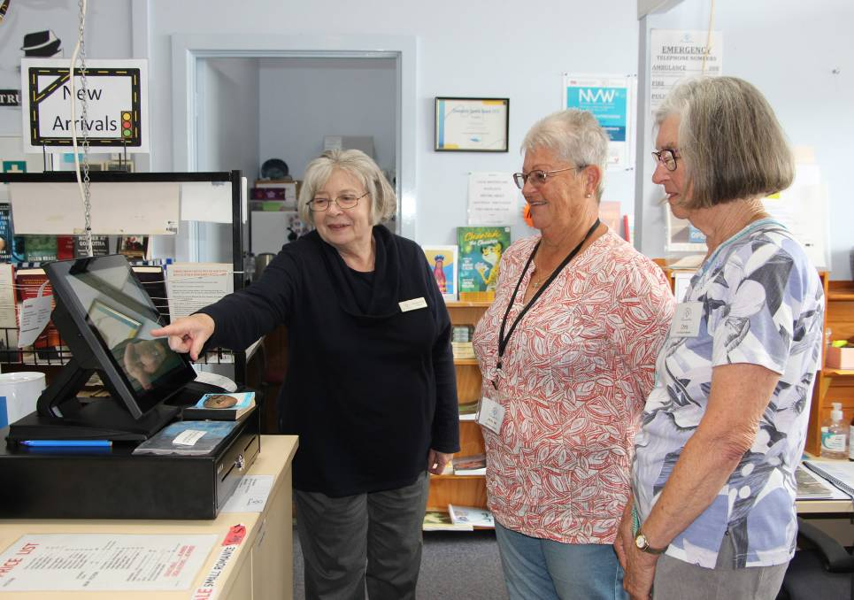 NEW SYSTEM: Eyre Peninsula Community Foundation director Maggie Knife trains Port Lincoln Book Bazaar volunteers Julie Lihou and Chris Houweling on use of the new point of sale system. Photo: Supplied