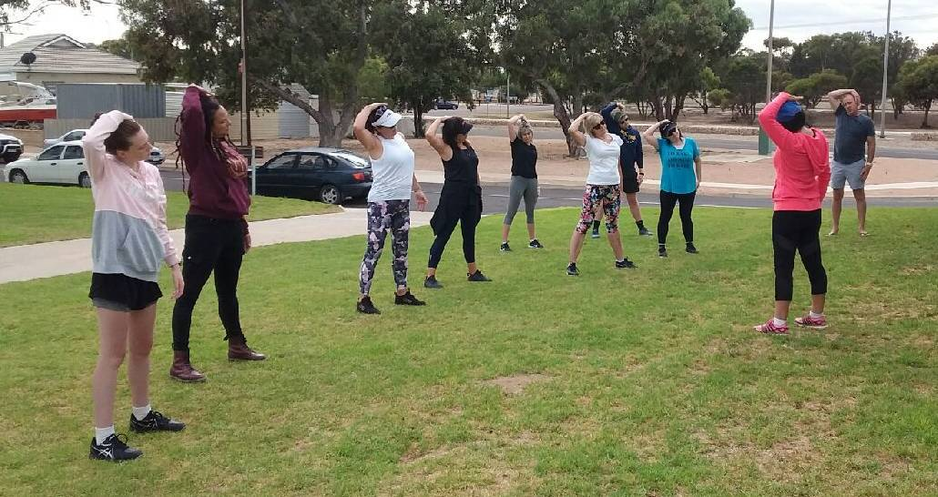YOGA: Participants undertake a yoga session following a wellbeing walk earlier this year. Picture: Supplied