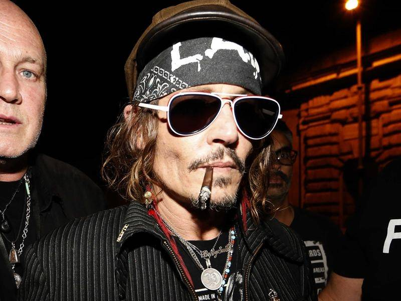 Johnny Depp is being sued by the location manager of his latest film for allegedly punching him.